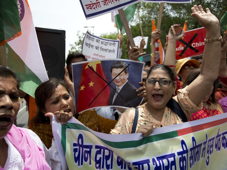 Activists of Swadeshi Jagaran Manch, a Hindu right-wing organization, shout slogans against China during a protest in New Delhi on July 4. They were protesting China's decision to suspend a Hindu pilgrimage to a site in Tibet following tensions between Indian and Chinese troops along the India-China border.