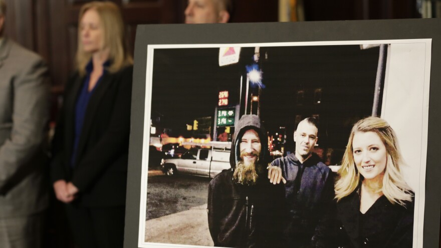 A picture of (from left) Johnny Bobbitt Jr., Mark D'Amico and Katelyn McClure was displayed during a news conference in November.