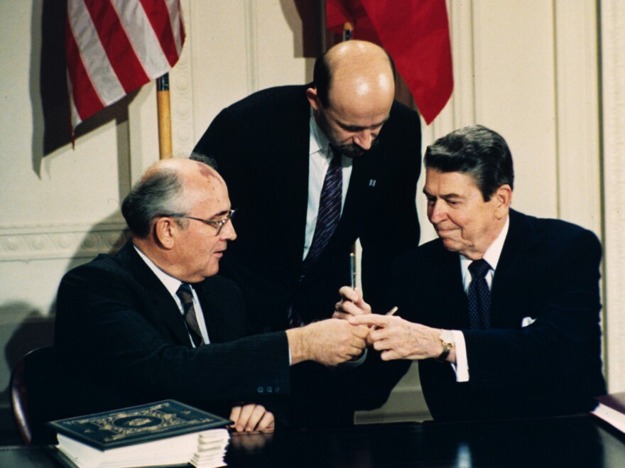 In this Dec. 8, 1987, file photo, President Ronald Reagan, right, and Soviet leader Mikhail Gorbachev exchange pens during the Intermediate Range Nuclear Forces Treaty signing ceremony in the White House East Room in Washington, D.C.