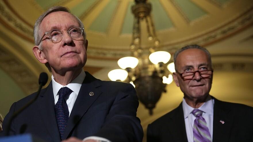 U.S. Senate Minority Leader Harry Reid, D-Nev., speaks to members of the media Sept. 9 at the Capitol. Reid is retiring after this Congress; he'll be succeeded as minority leader by Sen. Charles Schumer, D-N.Y. (right).