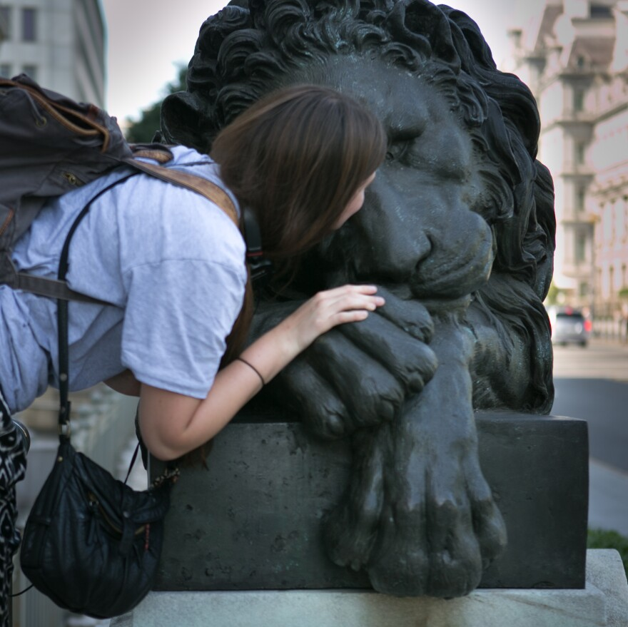Goodbye kiss: Corcoran College of Art + Design student Gen Fournier kisses one of the Corcoran's bronze Canova Lions.