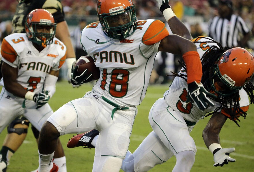 Florida A&M defensive celebrates an interception against South Florida during the first quarter of an NCAA college football game Saturday, Sept. 5, 2015, in Tampa, Fla.