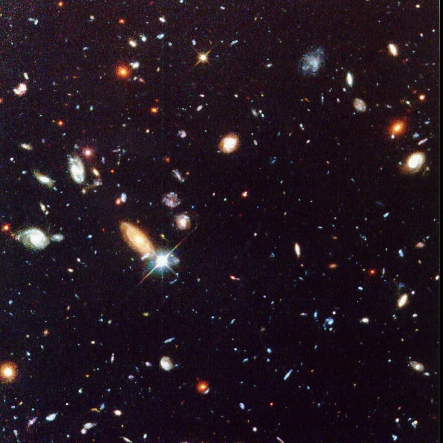 The view of the universe known as the Hubble Deep Field, presented in 1996, shows classical spiral and elliptical shaped galaxies, as well as a variety of other galaxy shapes.