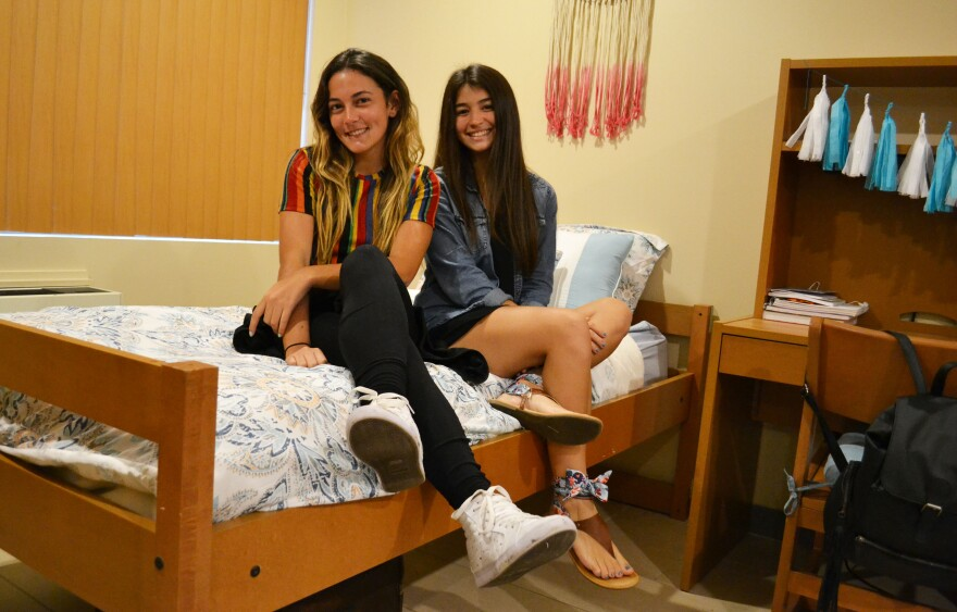Arantxa Mendez and Ledishla Acevedo relax in their new dorm room at St. Thomas University in Miami Gardens. They recently arrived here from Puerto Rico, where Hurricane Maria closed their colleges.