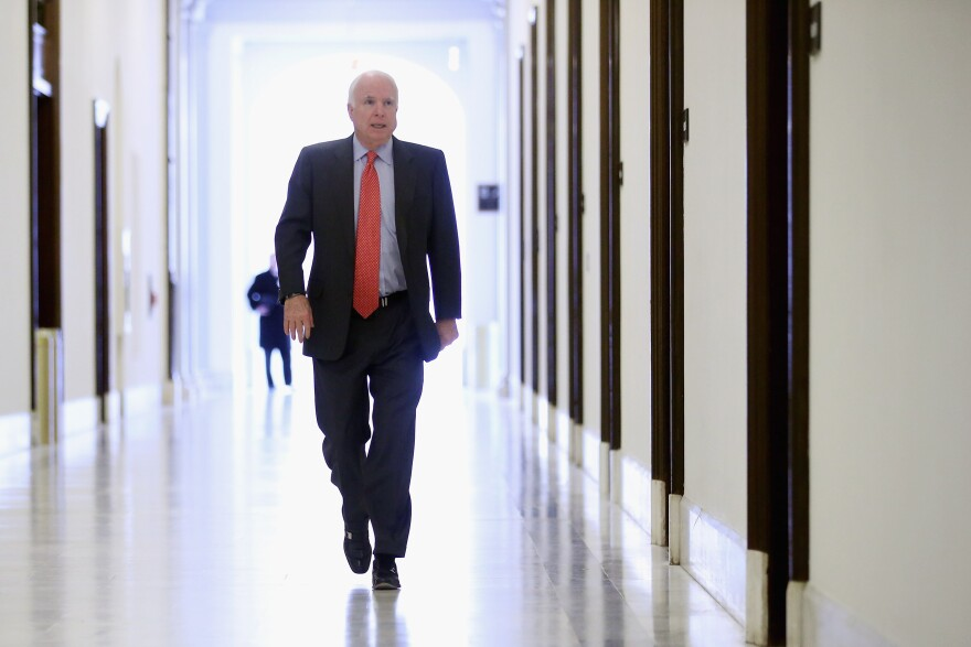 McCain heads to his office in the Russell Senate Office Building in 2013.