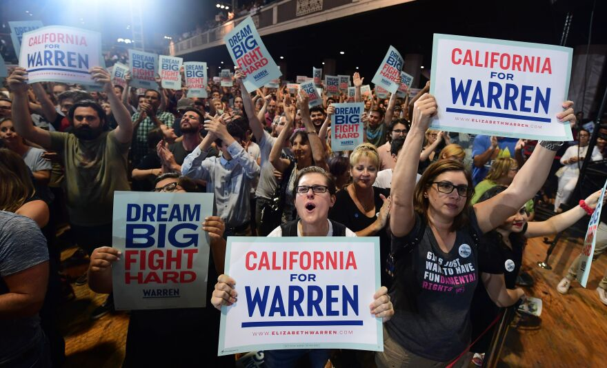 Warren supporters cheer as she hosts a town hall at the Shrine Auditorium in Los Angeles on Aug. 21.