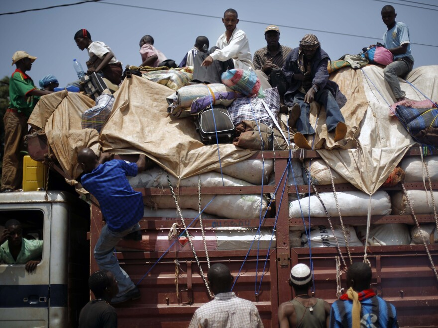 A convoy of more than 100 vehicles of Muslims flees Bangui, Central African Republic, on Feb. 14.