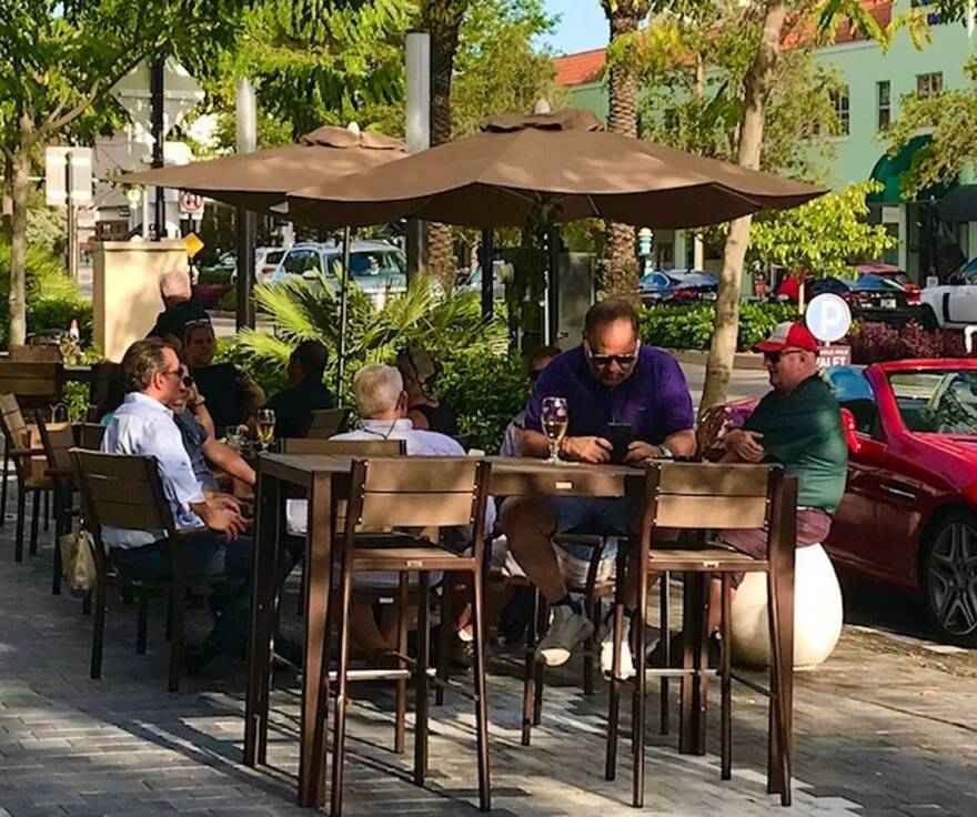 Customers gather at happy hour at John Martin's in Coral Gables.