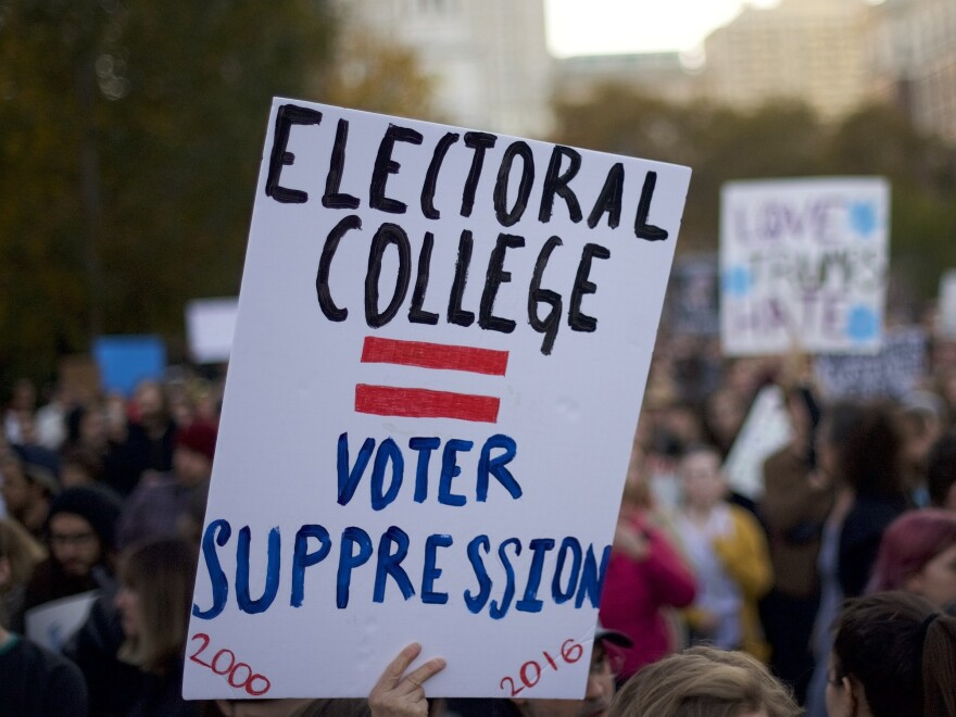Protesters demonstrate four years ago against Donald Trump, then the president-elect, outside Independence Hall in Philadelphia. Trump won the Electoral College but lost the popular vote by nearly 3 million votes.