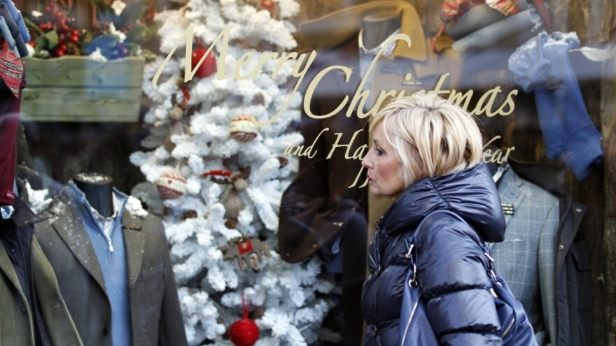 A woman gazes into a shop window in downtown Rome. Due to tough austerity measures, even wealthy Italians are buying less this holiday season.