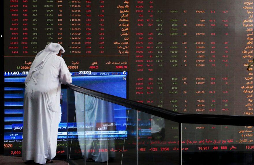 A Kuwaiti trader checks stock prices at Boursa Kuwait in Kuwait City.
