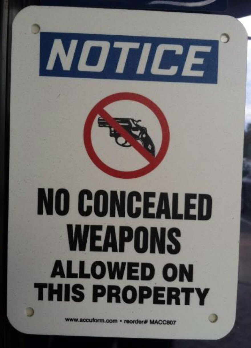 No concealed guns permitted on premise sign