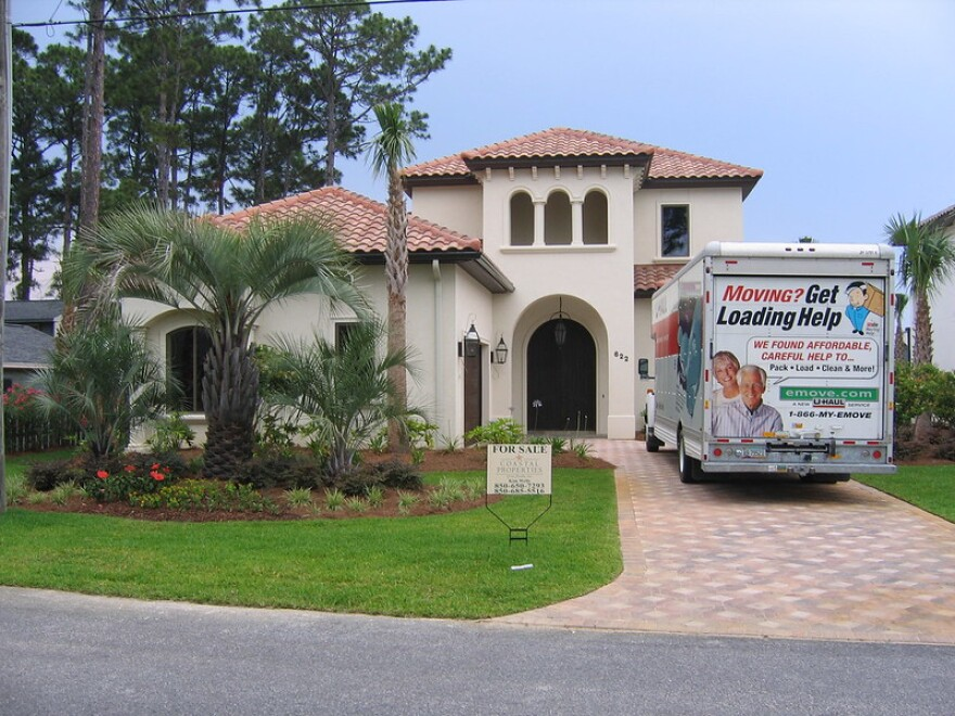 This house has a for sale sign and a moving truck out front. Census data shows that people from high-tax states in the Midwest and Northwest are still moving to Florida in droves. Credit: Andrew Guyton/flickr.com