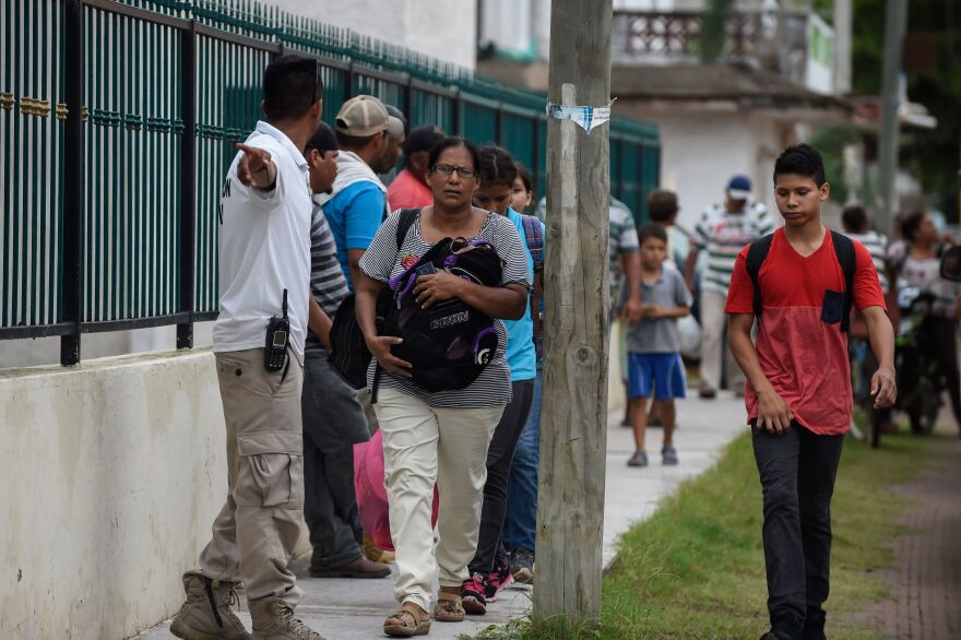 Residents in Teacapan, Mexico, prepare to evacuate on Monday.
