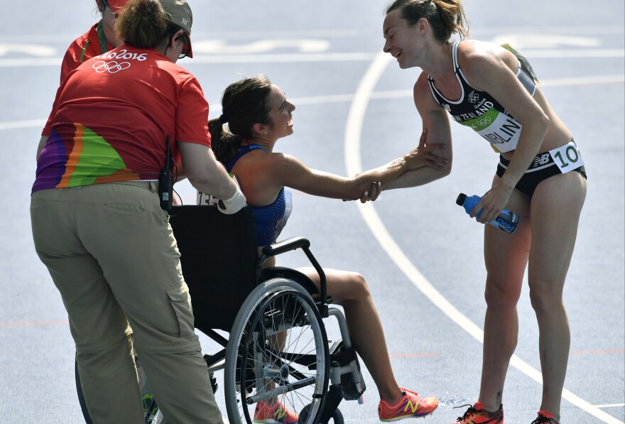 New Zealand's Nikki Hamblin (right) offers her support for America's Abbey D'Agostino as she is helped from the track after a heat in the women's 5,000 meters on Tuesday in Rio. Hamblin and D'Agostino fell during the race, and they encouraged each other to finish. Both advanced to the final because of the fall, but D'Agostino will not be able to run because of a torn ACL.