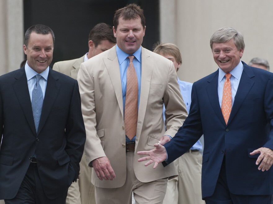 Former pitcher Roger Clemens, center, and his attorneys Rusty Hardin, right, and Michael Attanasio arrive on the courthouse steps after Clemens was found not guilty on all charges in his perjury trial at U.S. District Court in Washington, D.C., on Monday.