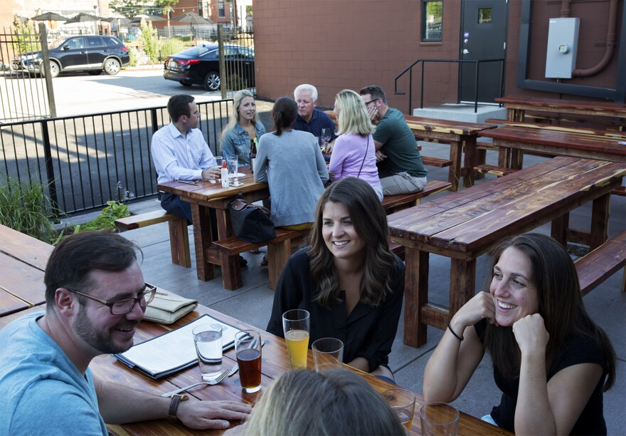 Patrons sit on the side patio at Charleville Brewing Co. & Tavern on June 27, 2017.
