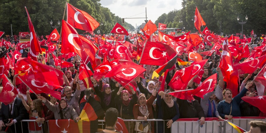 Germans with Turkish roots protest before the German Parliament on Wednesday, expressing their opposition to a resolution to recognize as genocide the killing of Armenians by Ottoman Turks starting in 1915. The resolution passed overwhelmingly on Thursday.