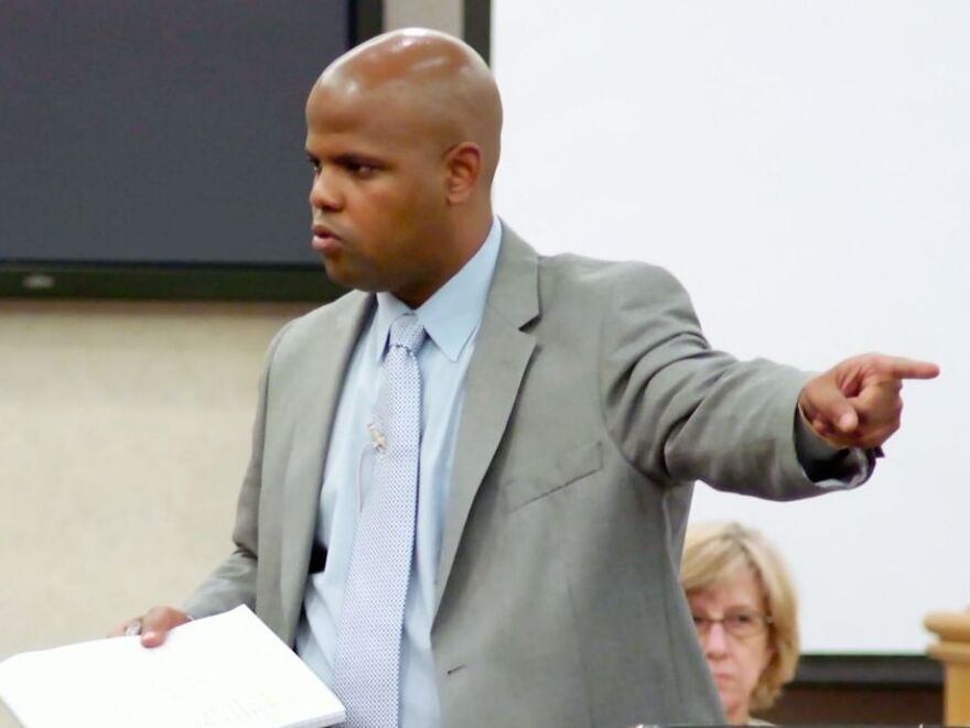 Travis Williams says, regardless of race, if you're poor it's harder to navigate the criminal justice system. If he loses a trial, he tattoos the client's name on his back.