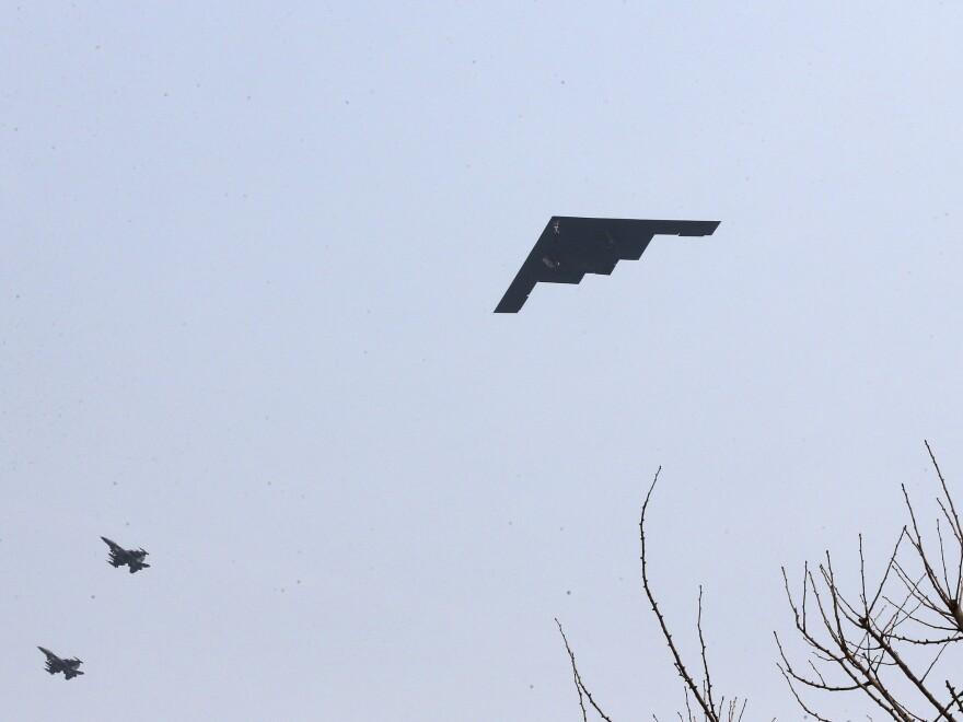 A U.S. Air Force B-2 stealth bomber flies near Osan U.S. Air Base in Pyeongtaek, south of Seoul, on Thursday.