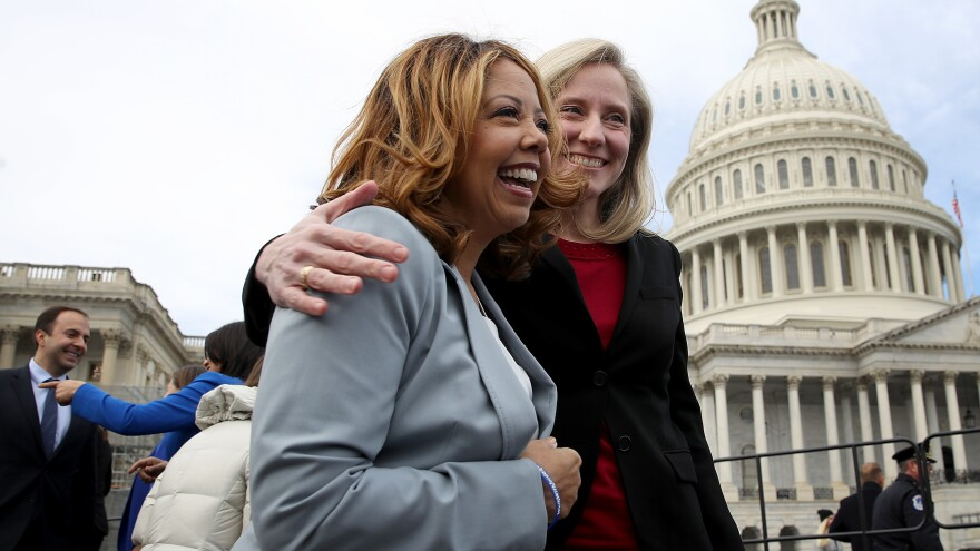 Newly elected members of the House of Representatives Lucy McBath and Abigail Spanberger meet in front of the U.S. Capitol. Both women represent newly Democratic suburban districts.