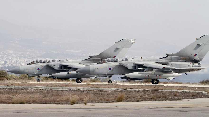Two Royal Air Force Tornado GR4 fighter jets prepare to take off Saturday from an airbase in Cyprus. The British warplanes were heading on their first mission over Iraq since being given parliamentary authority to strike at ISIS Friday.