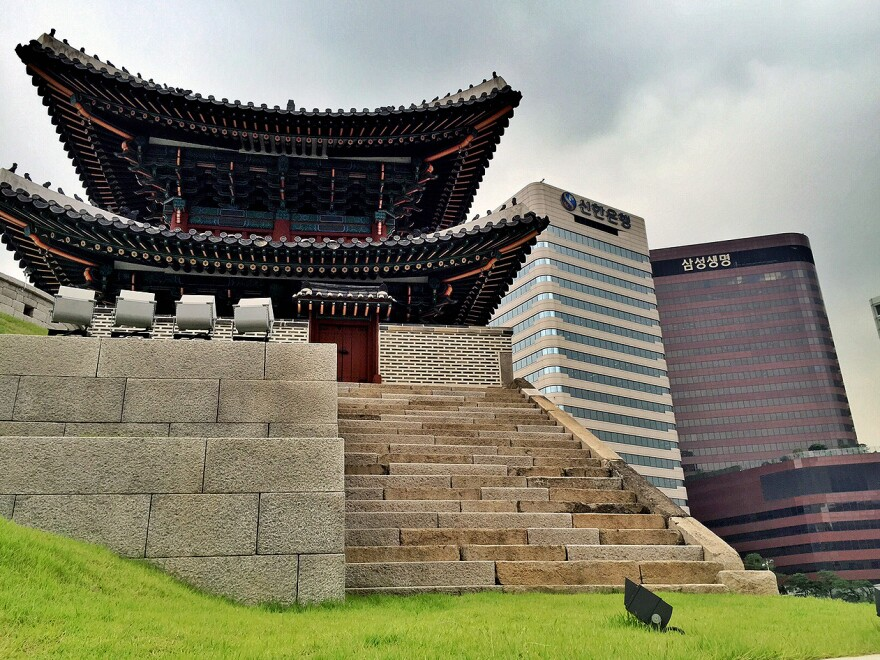 Traditional architecture and modern skyscrapers overlap in central Seoul.