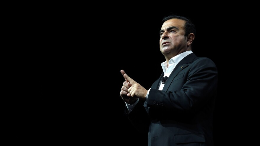 Carlos Ghosn, then Nissan's chairman and CEO, delivers a speech in Las Vegas in January 2017. Ghosn was widely celebrated for reviving Nissan after the company neared bankruptcy in 1999. Now he's been removed from leadership at the company after an internal investigation found financial misconduct.
