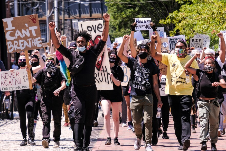 A crowd of peaceful protesters march through downtown Richmond, from Brown's Island to the 17th Street Market in Shockoe Bottom, June 7.