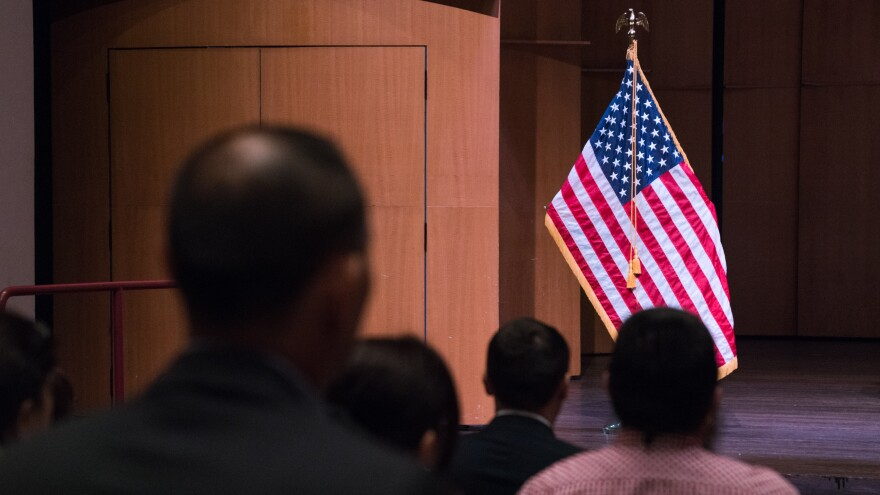 Newly sworn-in U.S. citizens gather for a naturalization ceremony in Alexandria, Va., in August. A potential trial over a new 2020 census citizenship question is set to start on Nov. 5 in New York City.