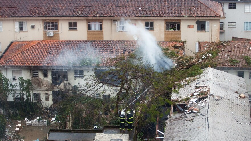 Rescuers work on the site of a plane crash in Sao Paulo, Brazil, on Wednesday. Presidential candidate Eduardo Campos was killed in the crash.