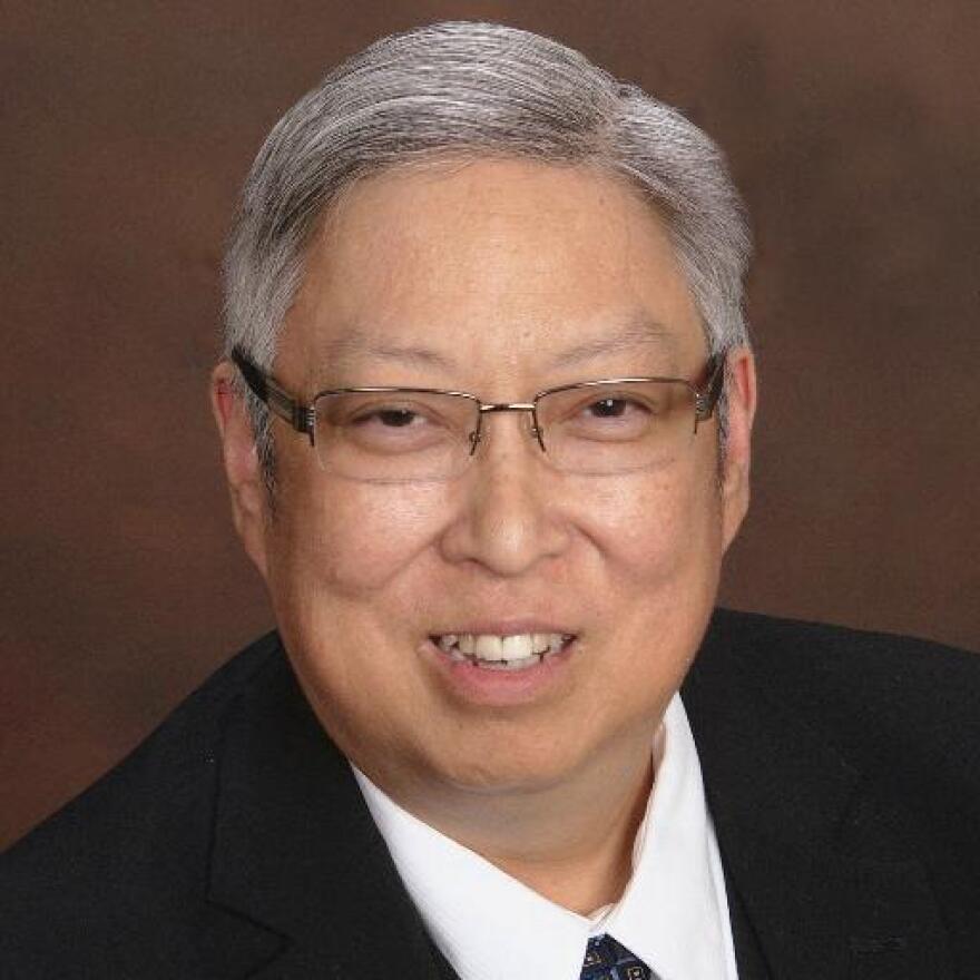 Headshot of the judge