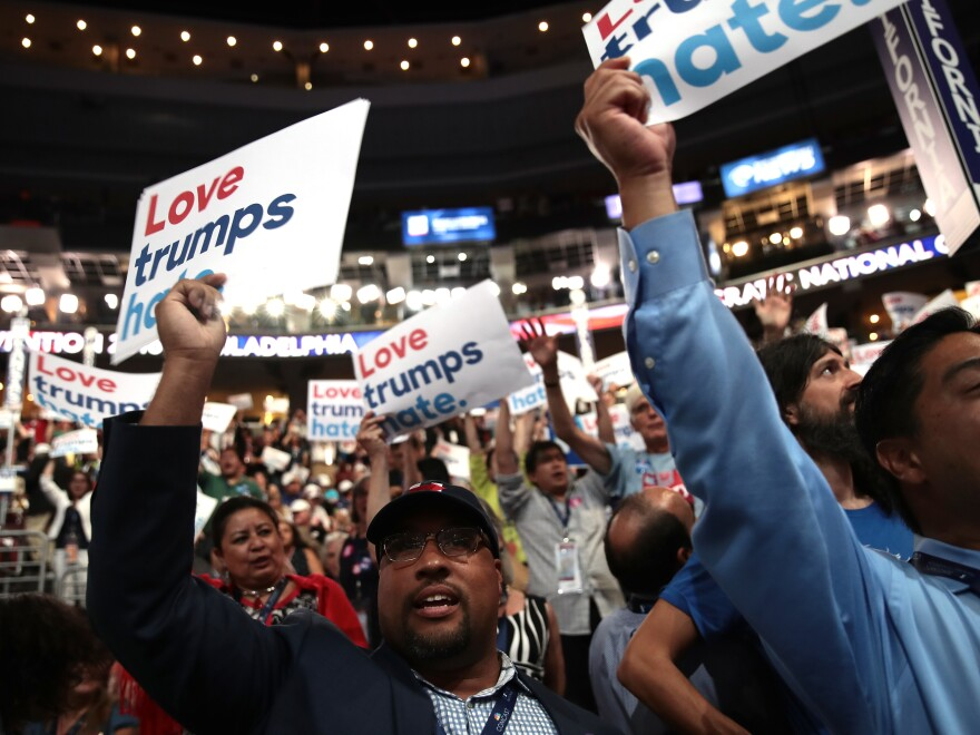"Delegates at the Democratic National Convention in Philadelphia in July hold up signs that read ""Love trumps hate."""