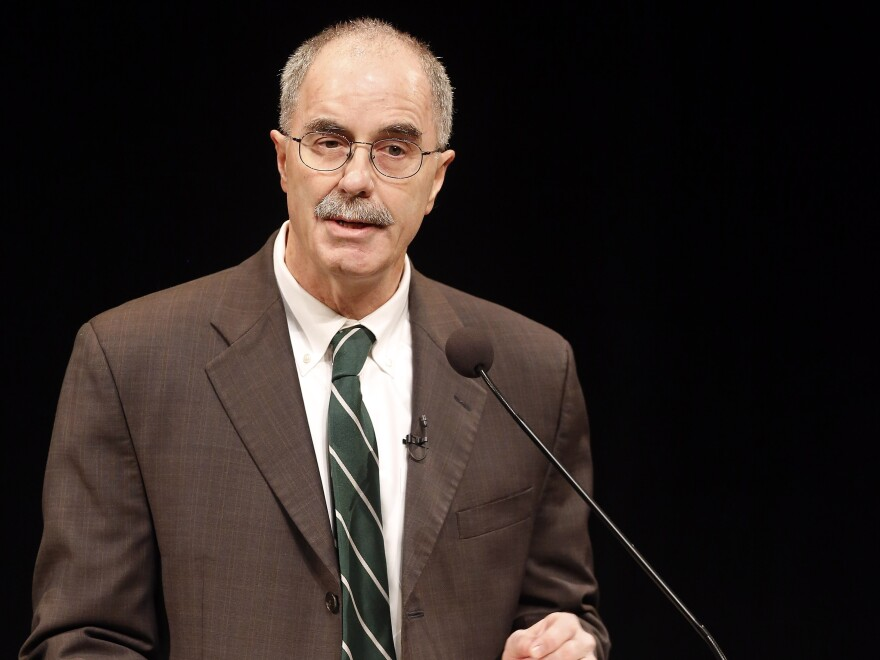 Dartmouth College President Philip Hanlon speaks Thursday to faculty and students about changes planned for the Ivy League school. Dartmouth banned hard liquor on campus and said all students will have to take part in a sexual violence prevention program all four years they are enrolled at the Ivy League school.