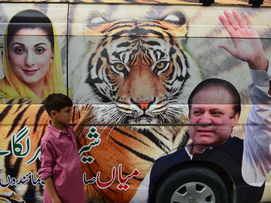 Pictures of ousted former Prime Minister Nawaz Sharif and his daughter Maryam Nawaz outside a campaign office in Rawalpindi, Pakistan.
