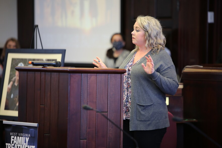 Family Treatment Court Coordinator Stephanie Smith speaks at a graduation ceremony for the first five families to successfully finish Nicholas County's program.