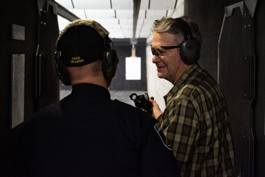 Idaho Gov. Brad Little attends an Idaho State Police gun range event in January. Little has been recruiting firearms manufacturers and Idaho is one of several gun-friendly states that have been landing places for gun companies leaving states with more restrictive gun laws.