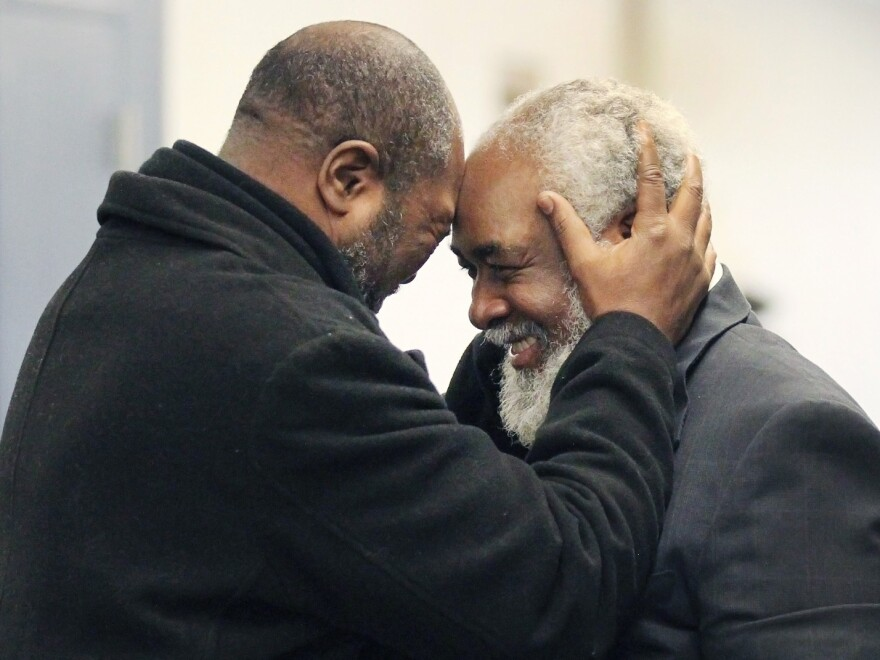 Kwame Ajamu (left) celebrates the release of his brother, Wiley Bridgeman, at a Cleveland courthouse. Bridgeman was convicted of a murder charge, along with Ajamu and Ricky Jackson, in 1975. They were exonerated when the witness recanted.