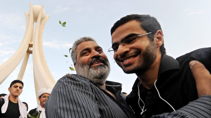Online activist Ali Abdulemam (right) is greeted in Manama, Bahrain, on Feb. 23, 2011, shortly after anti-government protests began. Wanted by the government, he went into hiding the following month. He escaped from Bahrain after two years underground and made his first public appearance Wednesday in Oslo, Norway.