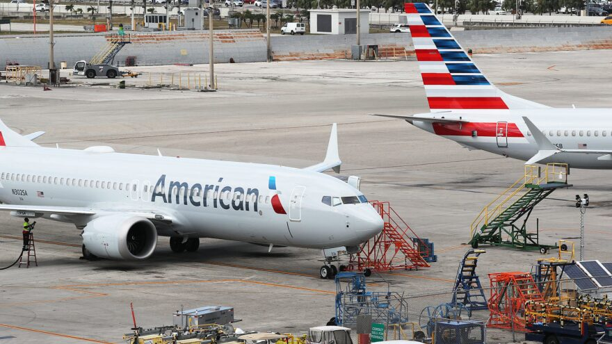 Two grounded American Airlines Boeing 737 Max 8s are seen parked in Miami in 2019. The airline industry is seeing more travelers than in March and April but faces a long road to recovery.