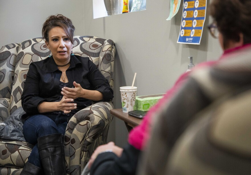 "Lindsay Bunker (left) talks to her counselor Regina Fox (right) at the NorthLakes Community Clinic in Ashland, Wisconsin. Bunker is in treatment for heroin addiction. She says the clinic's approach is helping: ""I love being here. I feel safe. I feel strong. I feel supported."""