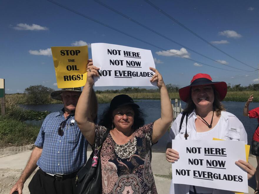 Environmentalists held signs in Everglades Holiday Park.