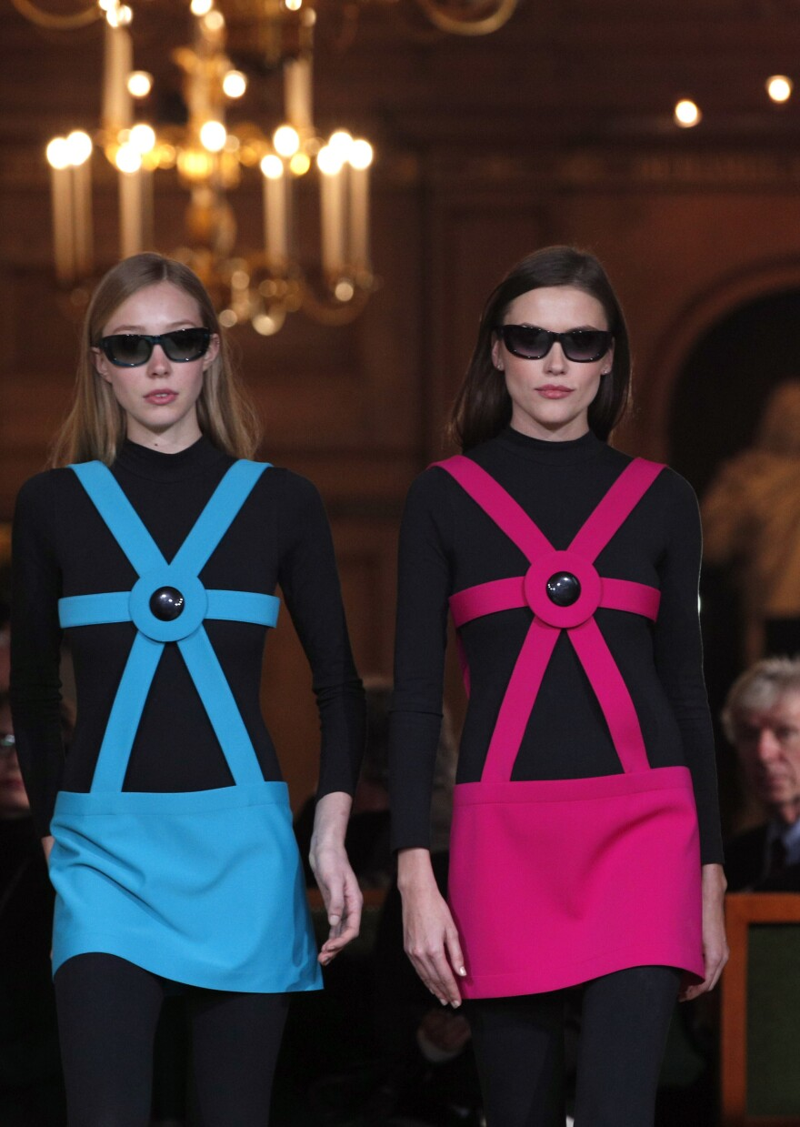 Models wear creations during a show to mark 70 years of creation by French fashion designer Pierre Cardin, in Paris in 2016.