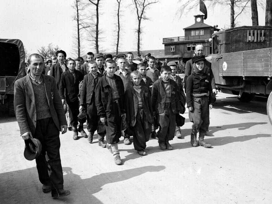 Children and other prisoners liberated by the U.S. Army march from Buchenwald concentration camp in April 1945.