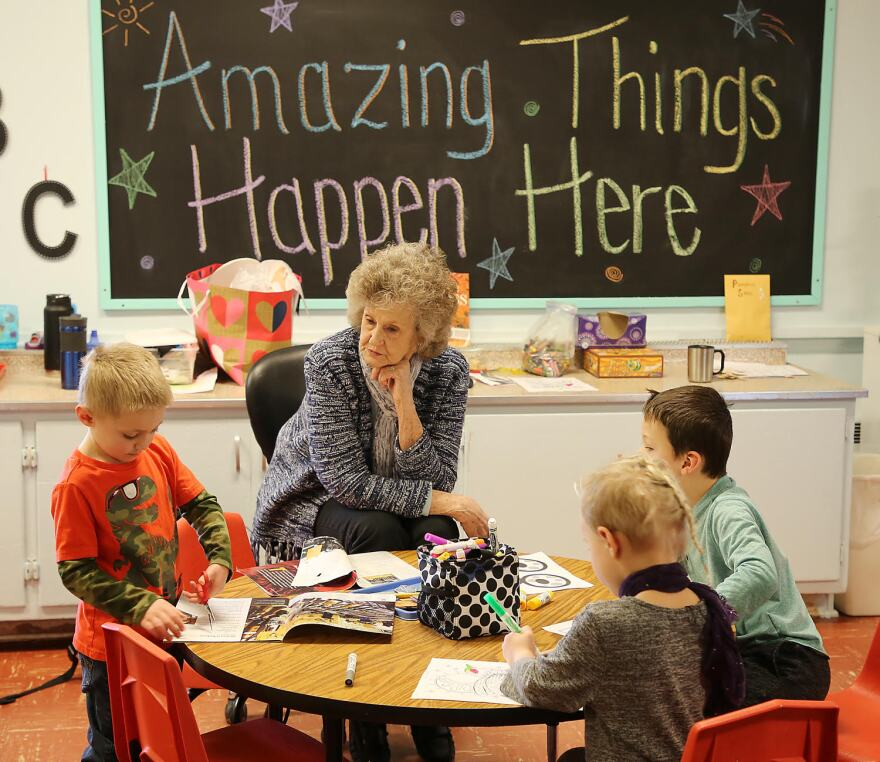 Pearl Hawkins leads a group of preschoolers cutting, coloring and creating during station time in the Seeley Lake Elementary classroom Jan. 10, 2020.