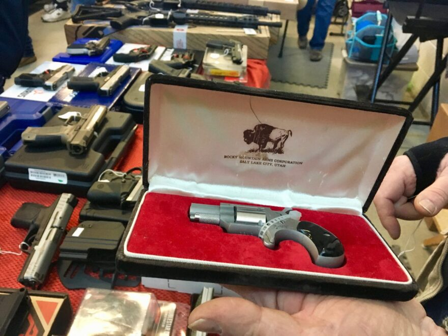 [FILE] A gun show promoter displays a pistol at an expo in Caldwell, Idaho. A gun industry trade group says 2018 was a strong year for the industry, possibly driven by fear of looming gun control measures.