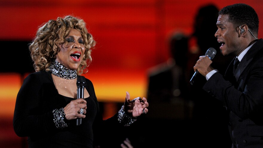 Roberta Flack (left) performs with Maxwell at the Grammy Awards in 2010.