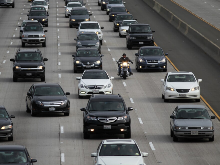 Morning traffic fills a freeway in Los Angeles. Seventeen automakers signed a letter to the Trump administration and California Gov. Gavin Newsom saying they want one set of policies to reduce greenhouse gases and make cars more fuel efficient.