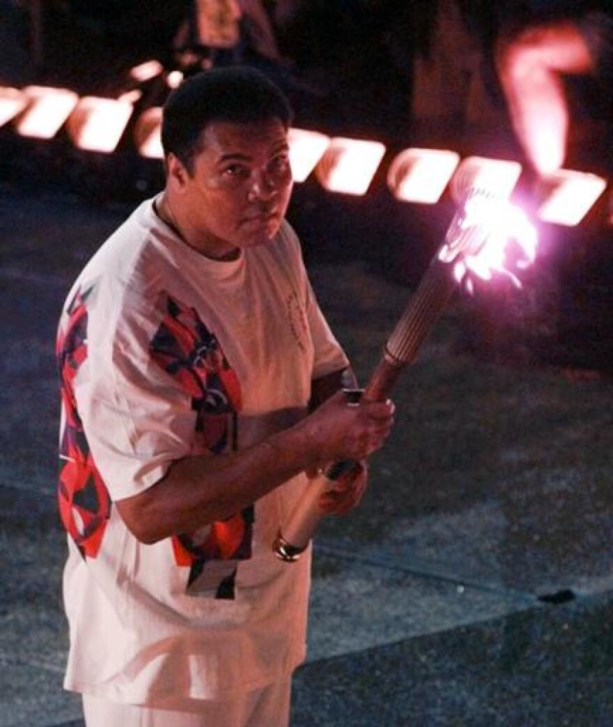 In this July 19, 1996, file photo, Muhammad Ali watches as the flame climbs up to the Olympic torch during the opening ceremonies of the Summer Olympics, in Atlanta.