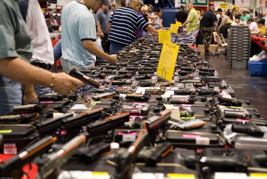 Potential gun buyers at a gun show. A surge in gun sales in recent months has also resulted in a backlog of background checks.